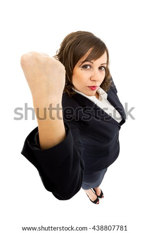 Businesswoman punching the air with anger isolated on white background shot with wide angle lenses