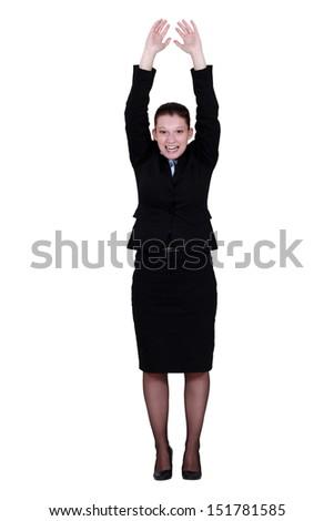 Businesswoman reaching up - stock photo