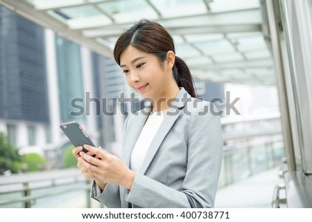 Businesswoman read on cellphone message
