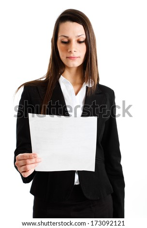 Businesswoman reading a business document - stock photo