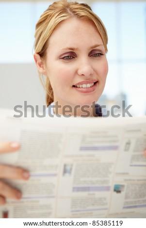 Businesswoman reading document - stock photo