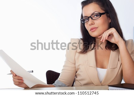 businesswoman reading document over white background - stock photo