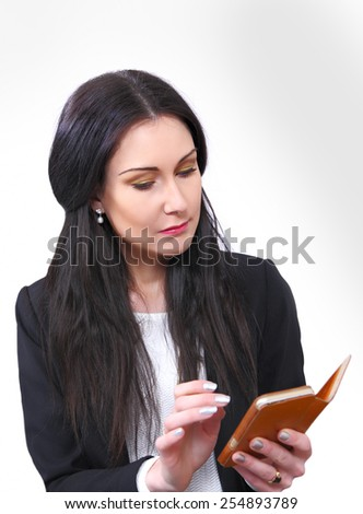 Businesswoman reading electronic planner or organizer - stock photo