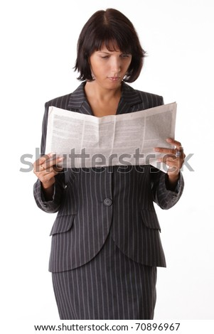 Businesswoman reading the paper
