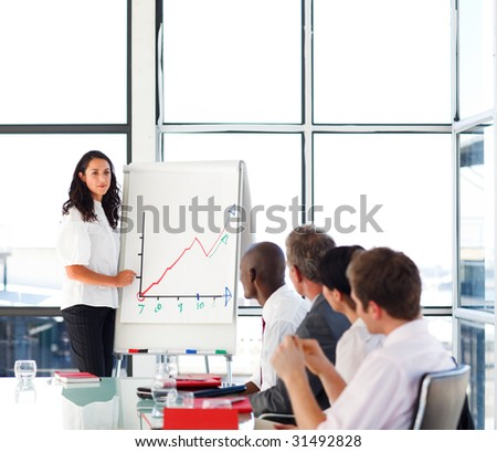 Businesswoman reporting sales figures to her international team - stock photo