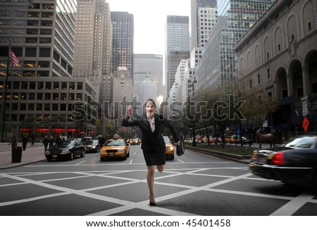 Businesswoman running in the middle of a city street