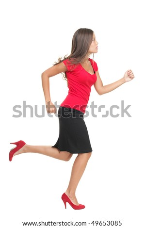 Businesswoman running isolated. Cutout of beautiful business woman casual dressed in red running in high heels in profile in full length. Isolated on white background. - stock photo