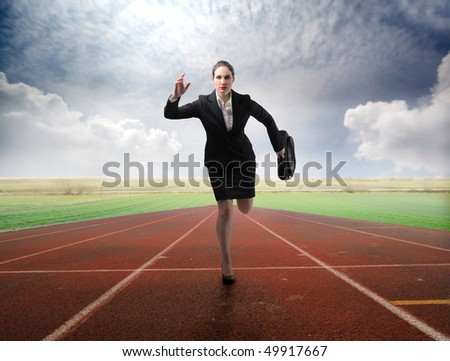 Businesswoman running on a running track