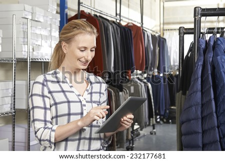 Businesswoman Running On Line Fashion Business With Digital Tablet - stock photo