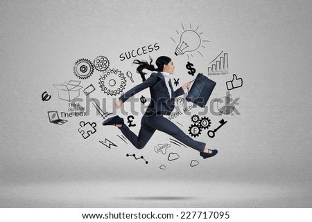 Businesswoman running to chase her aim for success - stock photo
