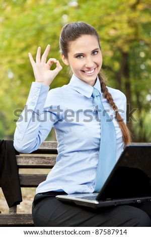 businesswoman satisfied with her work - stock photo