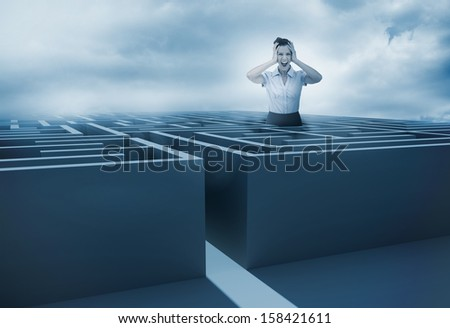 Businesswoman screaming and getting lost in a maze with dark sky on the background - stock photo
