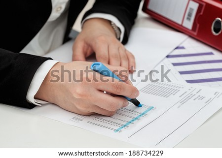 Businesswoman searching for an stock information