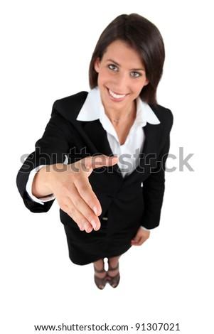 Businesswoman shaking hands - stock photo