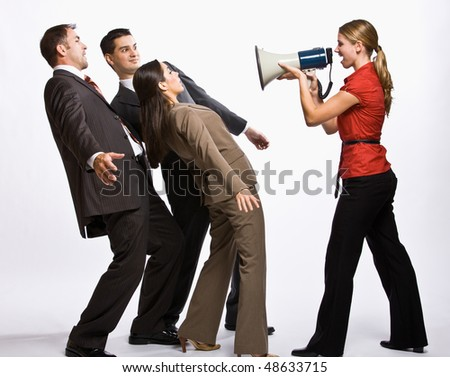 Businesswoman shouting with megaphone - stock photo