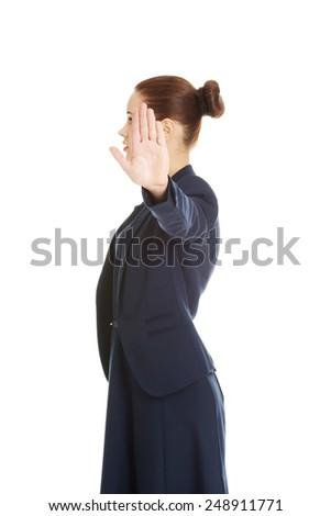 Businesswoman show NO gesture with confident expression.