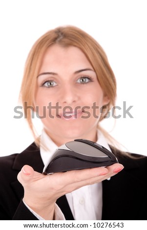 Businesswoman show wireless computer mouse in hand.( focus on mouse) - stock photo