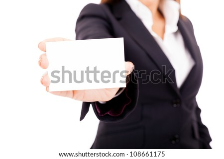 Businesswoman showing a blank business card, isolated on white