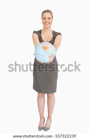 Businesswoman showing a globe against white background - stock photo