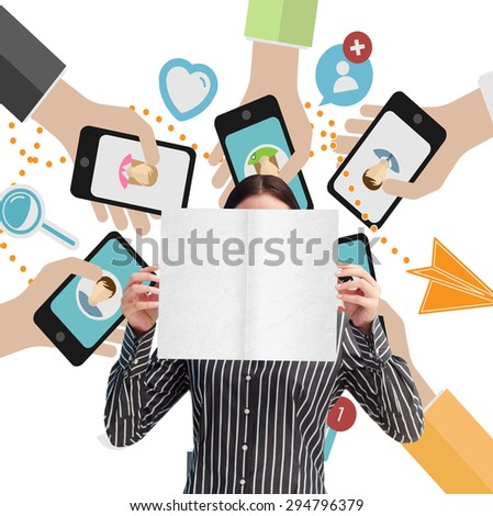Businesswoman showing a white card in front of her face against hands holding phones - stock photo