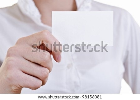 Businesswoman showing and handing a blank business card. Business woman in white shirt, high key.