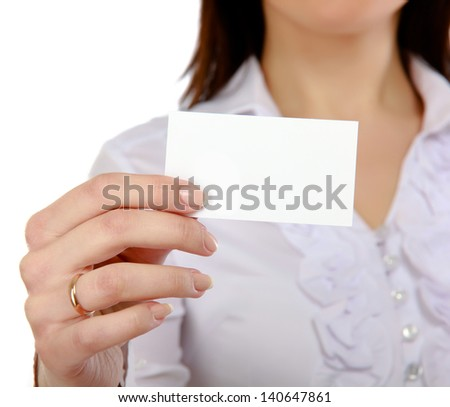 Businesswoman showing and handing a blank business card. Focus on card