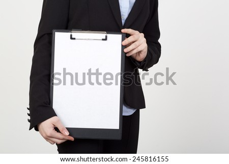 businesswoman showing blank paper - stock photo