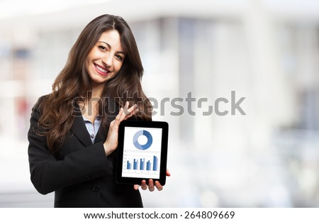 Businesswoman showing business graphs on a tablet computer - stock photo