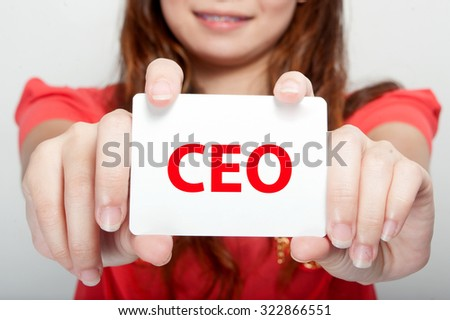 Businesswoman showing card with CEO message - stock photo