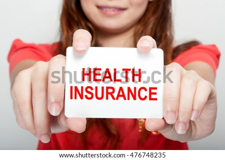 Businesswoman showing card with health insurance message,