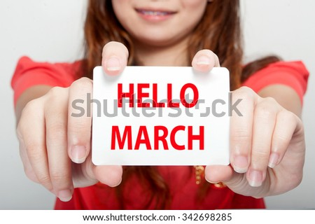 Businesswoman showing card with hello march message, - stock photo