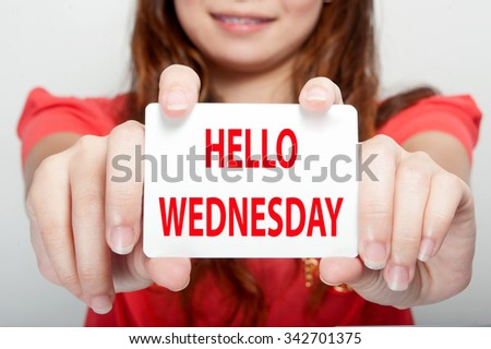 Businesswoman showing card with hello wednesday message, - stock photo