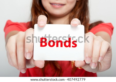 Businesswoman showing card with message, - stock photo