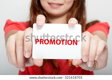 Businesswoman showing card with promotion message - stock photo