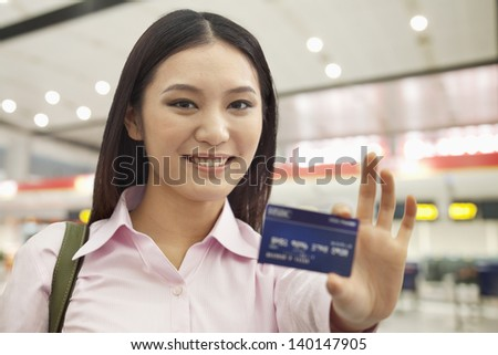 Businesswoman Showing Credit Card - stock photo