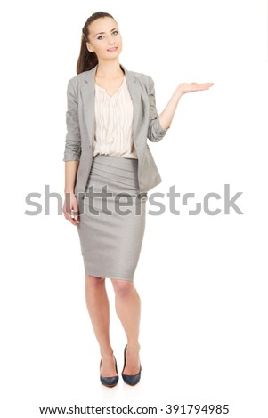 Businesswoman showing empty hand. - stock photo