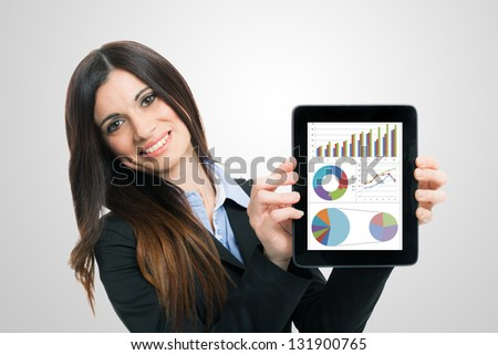 Businesswoman showing financial reports on a tablet computer - stock photo