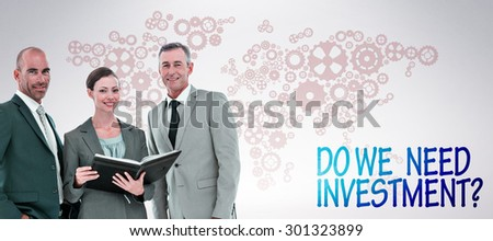Businesswoman showing her notes to her colleagues and smiling at the camera against grey background - stock photo