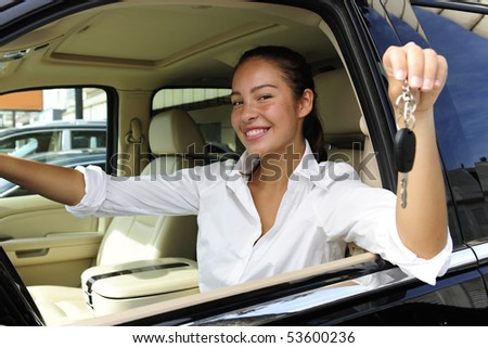 businesswoman showing keys of her new expensive  off-road vehicle - stock photo