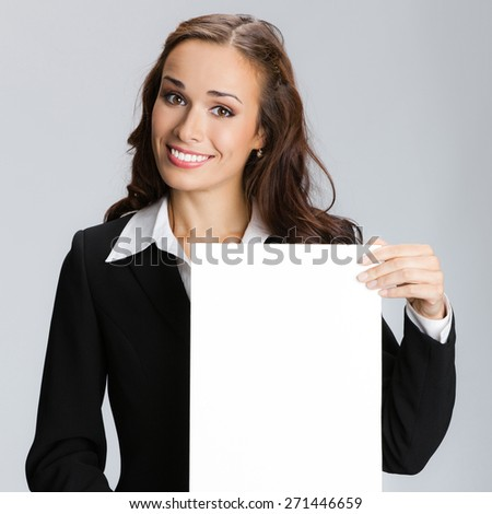 Businesswoman showing signboard with blank copyspace area for text or slogan - stock photo