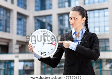 businesswoman showing that running out of time for payment of credit - stock photo