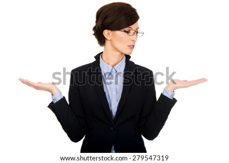 Businesswoman showing two empty hands for product. - stock photo
