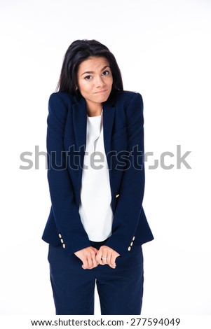 Businesswoman shrugging her shoulders over white background and looking at camera - stock photo