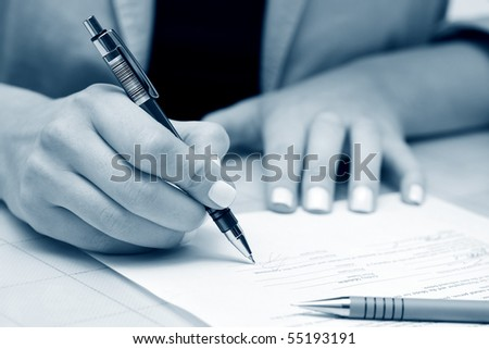 Businesswoman signing contract. - stock photo