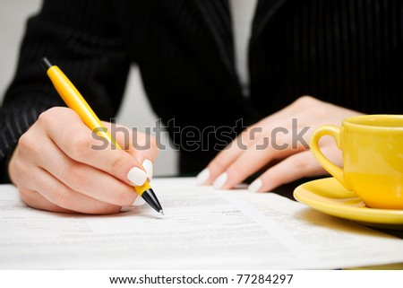 Businesswoman signing contract - stock photo
