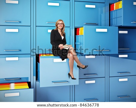 businesswoman sit on drawer of  cabinet folder