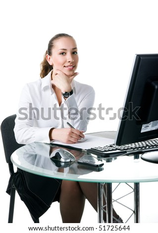 Businesswoman sits at the computer. Studio shot - stock photo