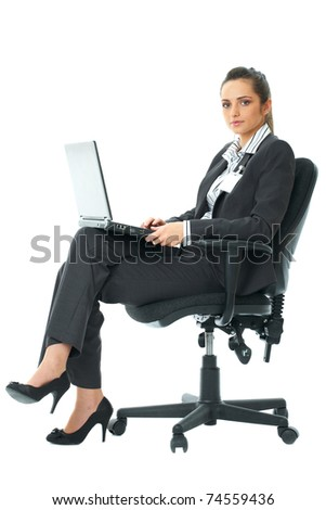 businesswoman sits on chair and work on her laptop, isolated on white