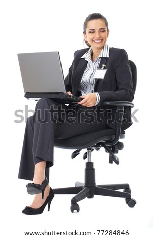 businesswoman sits on office chair and work on her laptop, isolated on white
