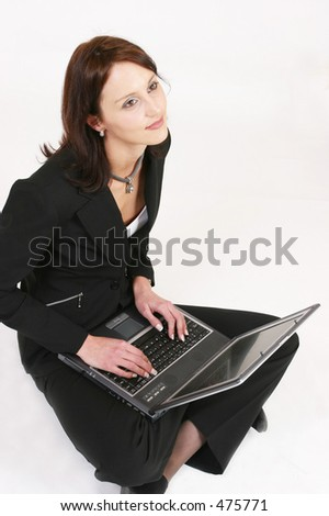 Businesswoman sitting and working on her computer